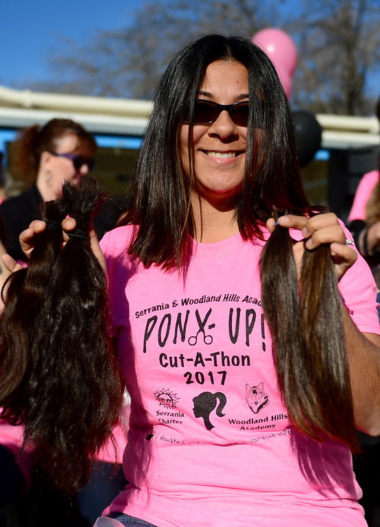 . During its outdoor school assembly, 57 students, teachers, and parents had their ponytails cut off by professional hair stylists from the community on Friday, February 24, 2017.  The fourth annual �Pony Up Cut-A-Thon� event at Serrania Charter for Enriched Studies elementary school included neighborhood middle school, Woodland Hills Academy.  The hair will be donated and made into wigs to help people with cancer.  Lorena Estrada shows her cut hair.  (Photo by Dean Musgrove, Los Angeles Daily News/SCNG)