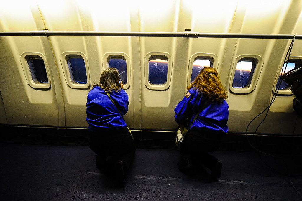 . Teachers Marie Thornsberry, right, and Wendi Rodriguez observe Mars and Venus from SOFIA, NASA\'s Stratospheric Observatory for Infrared Astronomy 747 plane, as they fly on a 10-hour, 5,000-mile flight from California to Texas, then up to British Columbia and back on Tuesday, Jan. 24, 2017.  Four educators, two from California and two from Wisconsin, flew on the flight at part of NASA\'s Airborne Astronomy Ambassadors program. (Photo by Rachel Luna/The Sun, SCNG)