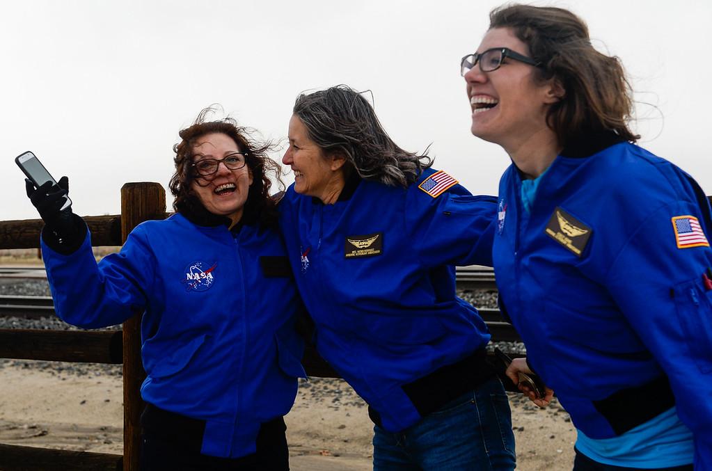 . (Left to right) Teachers Marie Thornsberry, Wendi Rodriguez and Ashley Adams watch SOFIA, NASA\'s Stratospheric Observatory for Infrared Astronomy 747 plane, fly out of the NASA Armstrong Flight Research Center at Palmdale Regional Airport in Palmdale, Calif. on Monday, Jan. 23, 2017. Four educators, two from California and two from Wisconsin, flew on the flight at part of NASA\'s Airborne Astronomy Ambassadors program on Jan. 24. (Photo by Rachel Luna/The Sun, SCNG)