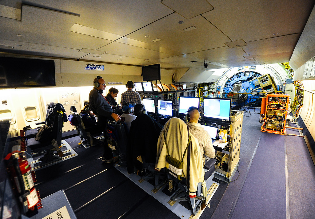 . NASA flight crews and scientists work during a mission flight on SOFIA, NASA\'s Stratospheric Observatory for Infrared Astronomy 747 plane, as they fly on a 10-hour, 5,000-mile flight from California to Texas, then up to British Columbia and back on Tuesday, Jan. 24, 2017. Four educators, two from California and two from Wisconsin, flew on the flight at part of NASA\'s Airborne Astronomy Ambassadors program. (Photo by Rachel Luna/The Sun, SCNG)