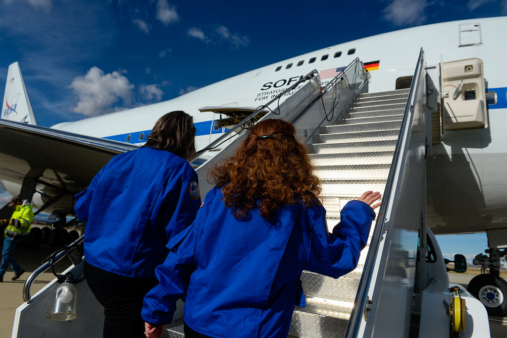 . Teachers Marie Thornsberry, right, and Wendi Rodriguez board SOFIA, NASA\'s Stratospheric Observatory for Infrared Astronomy 747 plane, at the NASA Armstrong Flight Research Center at Palmdale Regional Airport in Palmdale, Calif. on Tuesday, Jan. 24, 2017.  Four educators, two from California and two from Wisconsin, flew on the flight at part of NASA\'s Airborne Astronomy Ambassadors program. (Photo by Rachel Luna/The Sun, SCNG)
