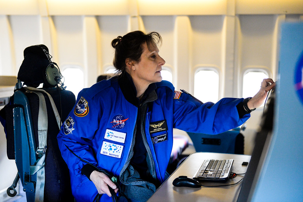 . Pamela Harman, co-manager of NASA\'s Airborne Astronomy Ambassadors program, guides teachers as they observe data NASA scientists gather during a mission flight on SOFIA, NASA\'s Stratospheric Observatory for Infrared Astronomy 747 plane, as they fly on a 10-hour, 5,000-mile flight from California to Texas, then up to British Columbia and back on Tuesday, Jan. 24, 2017.  Four educators, two from California and two from Wisconsin, flew on the flight at part of NASA\'s Airborne Astronomy Ambassadors program. (Photo by Rachel Luna/The Sun, SCNG)