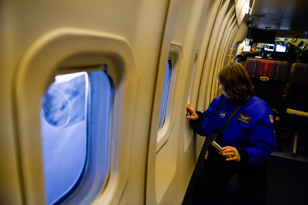 . Science teacher Wendi Rodriguez observes Mars and Venus from SOFIA, NASA\'s Stratospheric Observatory for Infrared Astronomy 747 plane, as they fly on a 10-hour, 5,000-mile flight from California to Texas, then up to British Columbia and back on Tuesday, Jan. 24, 2017.  Four educators, two from California and two from Wisconsin, flew on the flight at part of NASA\'s Airborne Astronomy Ambassadors program. (Photo by Rachel Luna/The Sun, SCNG)