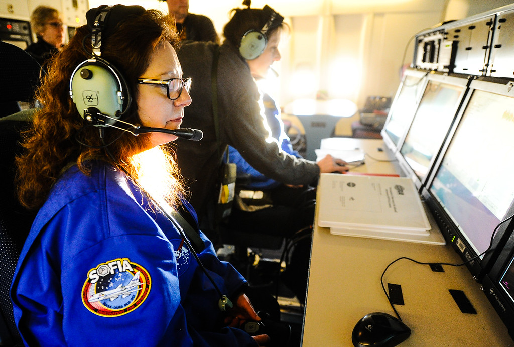 . Rialto Unified third grade teacher Marie Thornsberry observes data NASA scientists gather during a mission flight on SOFIA, NASA\'s Stratospheric Observatory for Infrared Astronomy 747 plane, as they fly on a 10-hour, 5,000-mile flight from California to Texas, then up to British Columbia and back on Tuesday, Jan. 24, 2017.  Four educators, two from California and two from Wisconsin, flew on the flight at part of NASA\'s Airborne Astronomy Ambassadors program. (Photo by Rachel Luna/The Sun, SCNG)