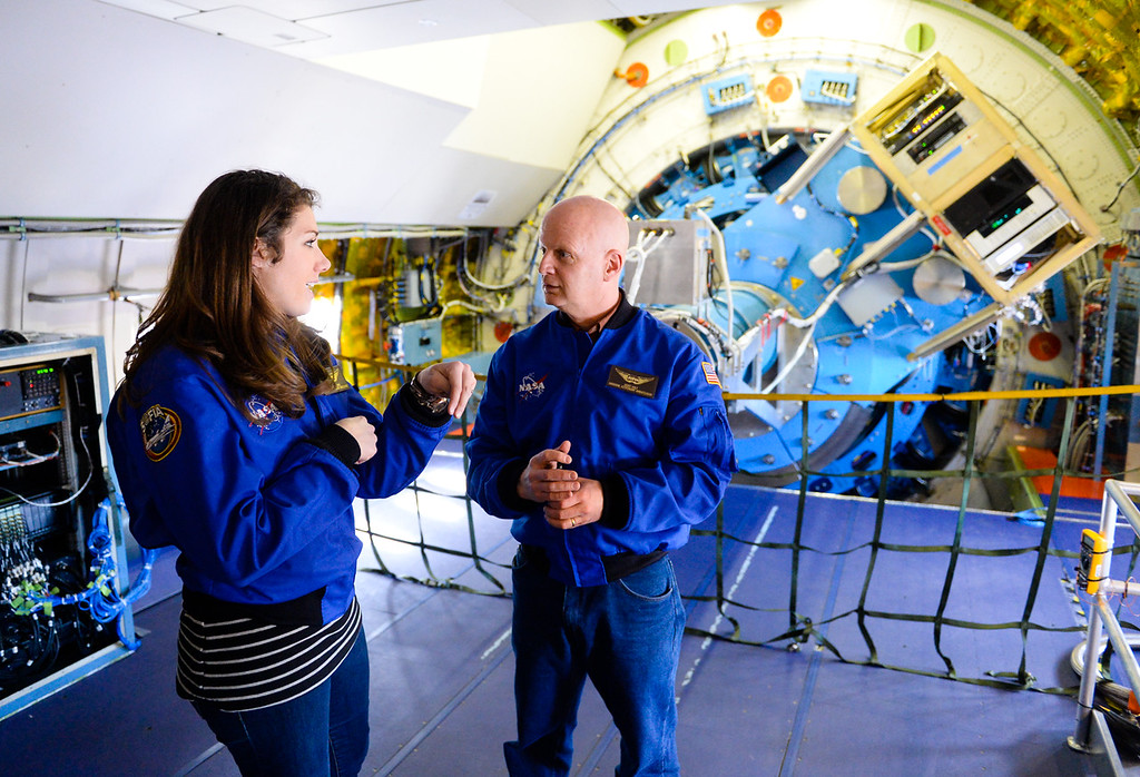 . Wisconsin seventh and eight grade science teacher Ashely Adams and Geoff Holt, who runs a planetarium for the Madison Metropolitan School District in Madison, Wisconsin, chat in front of the infrared telescope on SOFIA, NASA\'s Stratospheric Observatory for Infrared Astronomy 747 plane at the NASA Armstrong Flight Research Center at Palmdale Regional Airport in Palmdale, Calif. on Tuesday, Jan. 24, 2017.  Four educators, two from California and two from Wisconsin, flew on the flight at part of NASA\'s Airborne Astronomy Ambassadors program. (Photo by Rachel Luna/The Sun, SCNG)