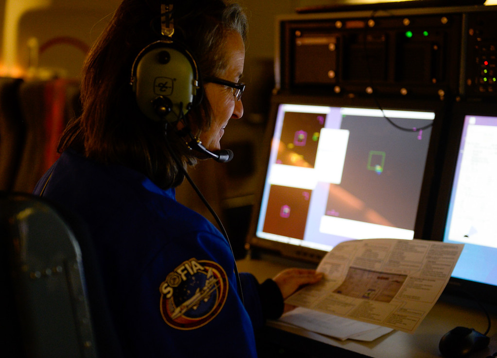 . Snowline Joint Unified middle school science teacher Wendi Rodriguez observes data NASA scientists gather during a mission flight on SOFIA, NASA\'s Stratospheric Observatory for Infrared Astronomy 747 plane, as they fly on a 10-hour, 5,000-mile flight from California to Texas, then up to British Columbia and back on Tuesday, Jan. 24, 2017.  Four educators, two from California and two from Wisconsin, flew on the flight at part of NASA\'s Airborne Astronomy Ambassadors program. (Photo by Rachel Luna/The Sun, SCNG)