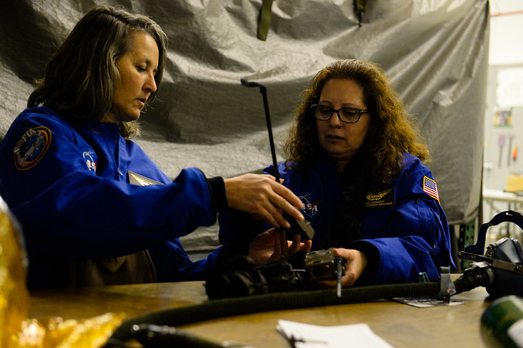 . (Left to right) Wendi Rodriguez, a middle school science teacher at Heritage School in Snowline Joint Unified in the High Desert, participate in NASA\'s Airborne Astronomy Ambassadors program undergo egress training at the NASA Armstrong Flight Research Center at Palmdale Regional Airport in Palmdale, Calif. on Monday, Jan. 23, 2017.  Four educators, two from California and two from Wisconsin, flew on the flight at part of NASA\'s Airborne Astronomy Ambassadors program. (Photo by Rachel Luna/The Sun, SCNG)