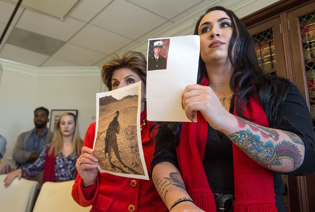 . Former Marine Erika Butner, right, and attorney Gloria Allred show photographs of herself while she was in active duty during a press conference in Los Angeles on Wednesday, March 08, 2017. (Photo by Ed Crisostomo, Los Angeles Daily News/SCNG)