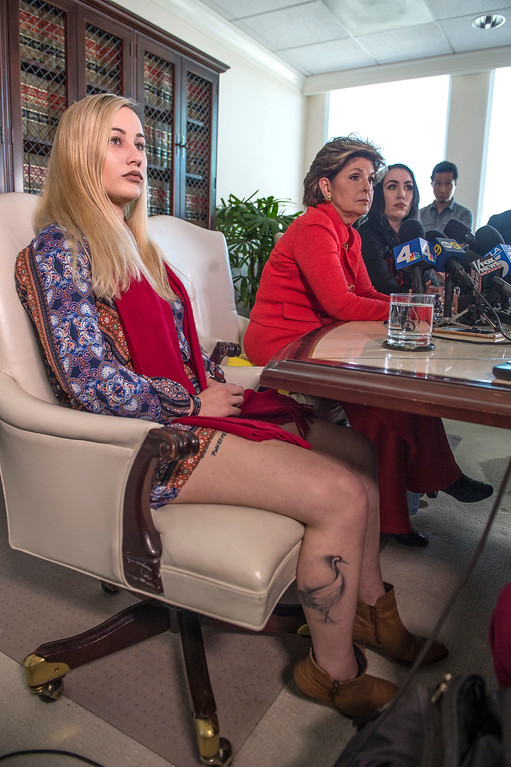 . Marisa Woytek, from left, active duty Marine, attorney Gloria Allred and Erika Butner, former Marine, hear questions from the media during a press conference in Los Angeles on Wednesday, March 08, 2017. (Photo by Ed Crisostomo, Los Angeles Daily News/SCNG)