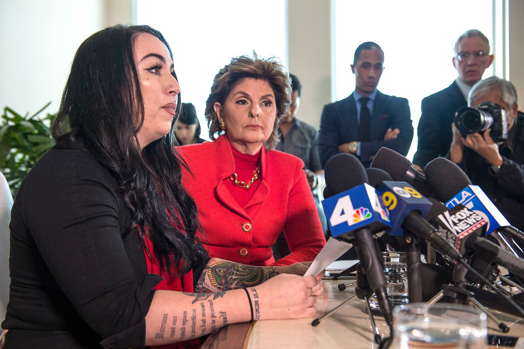 . Former Marine Erika Butner, left, addresses the media as attorney Gloria Allred looks on during a press conference in Los Angeles on Wednesday, March 08, 2017. (Photo by Ed Crisostomo, Los Angeles Daily News/SCNG)