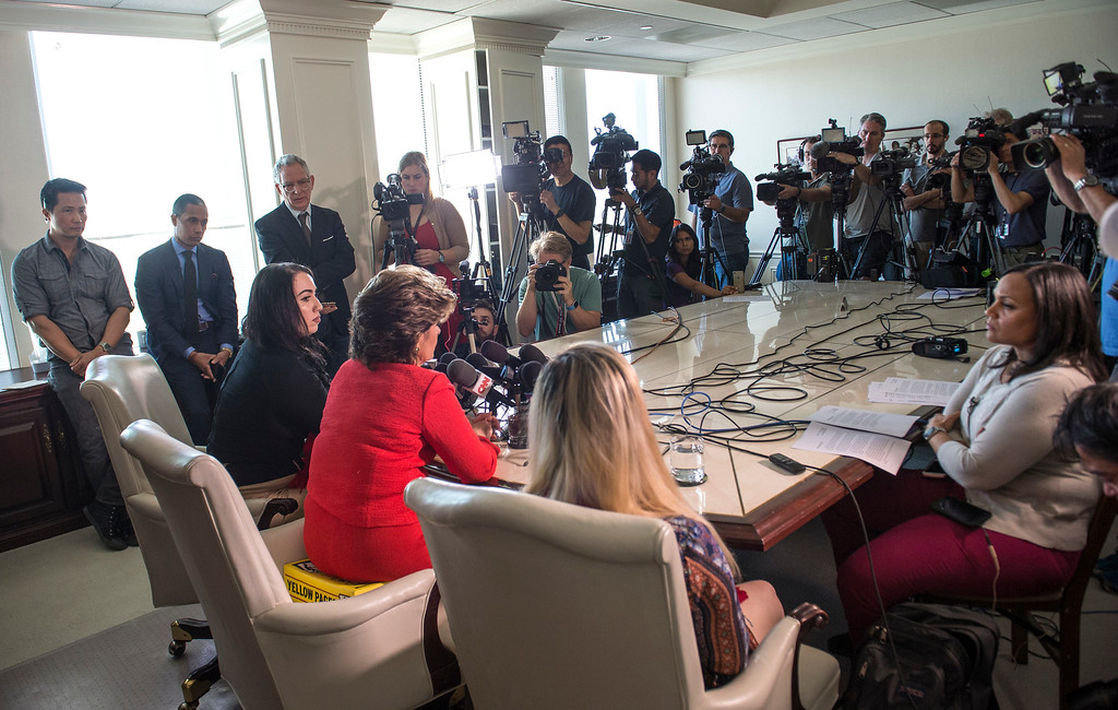 . Attorney Gloria Allred, center, addresses the media as Erika Butner, left, former Marine, and Marisa Woytek, active duty Marine, look on during a press conference in Los Angeles on Wednesday, March 08, 2017. (Photo by Ed Crisostomo, Los Angeles Daily News/SCNG)