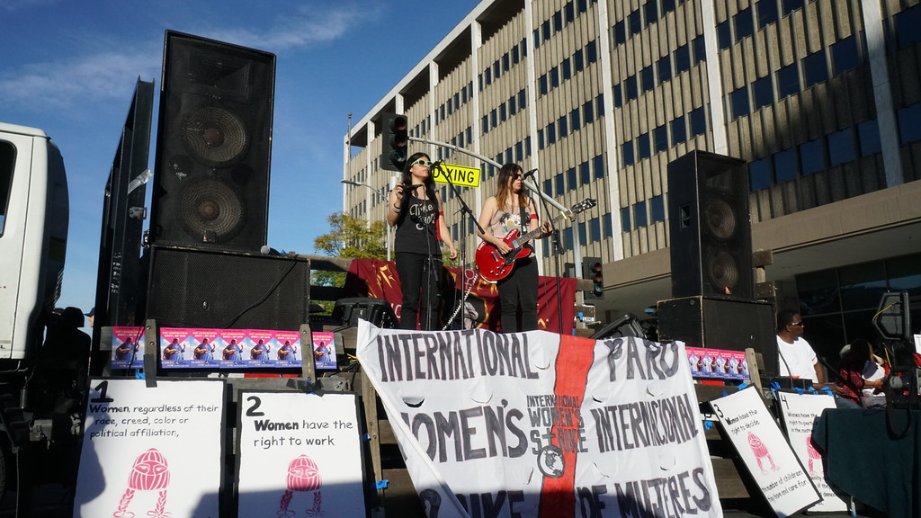 . A band called Miracle Dolls performs as part of the International Women\'s Strike rally outside the federal building in downtown Los Angeles. (Photo by Matthew Carey/Special to the Los Angeles Daily News)