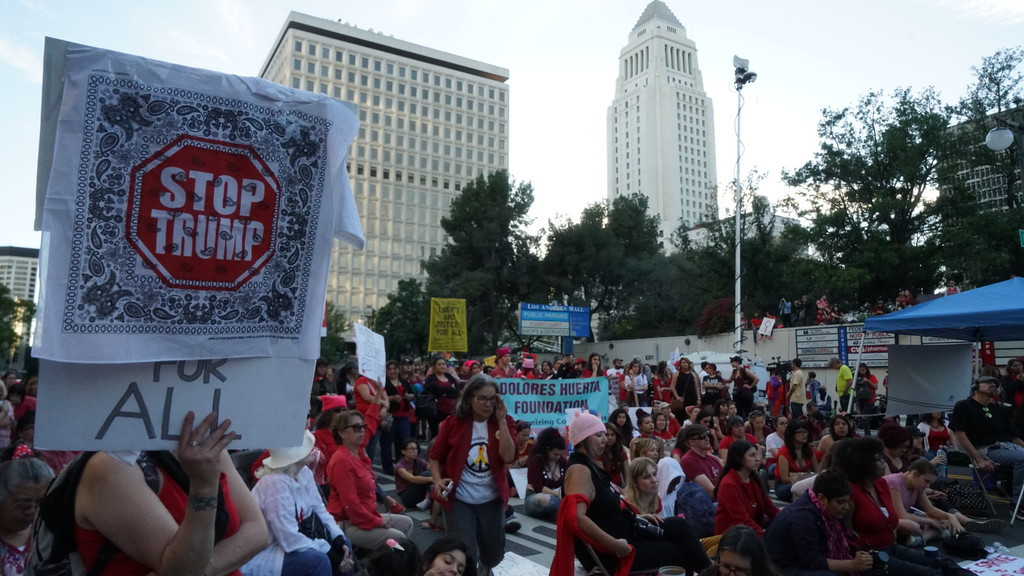. A crowd of several hundred took part in an International Women\'s Strike rally in downtown Los Angeles. In the background is Parker Center.  (Photo by Matthew Carey/Special to the Los Angeles Daily News)