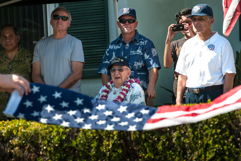 . World War II veteran Lauren Bruner, center, 96, watches as  members of Boy Scout Troop 749, prepare to raise the American Flag during a flag-raising ceremony in La Mirada on Saturday, March 11, 2017. Lauren Bruner is one of the remaining survivors of the Pearl Harbor attack on Dec. 7, 1941. Bruner was stationed on the USS Arizona. (Photo by Ed Crisostomo, Los Angeles Daily News/SCNG)