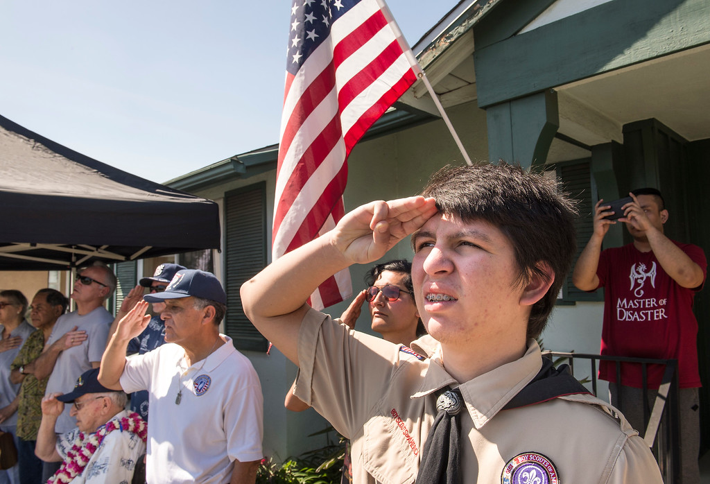 . Thomas Powers, right, Boy Scout Troop 749, salutes during a flag-raising ceremony in La Mirada on Saturday, March 11, 2017. (Photo by Ed Crisostomo, Los Angeles Daily News/SCNG)