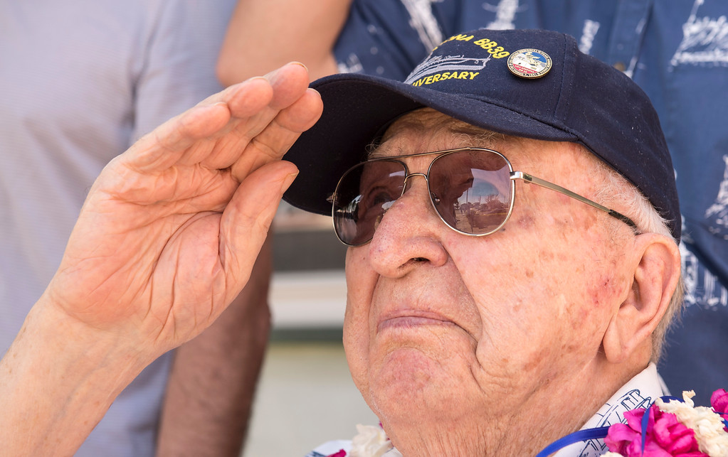 . World War II veteran Lauren Bruner, 96, salutes as members of Boy Scout Troop 749, raises the American Flag during a flag-raising ceremony in La Mirada on Saturday, March 11, 2017. Lauren Bruner is one of the remaining survivors of the Pearl Harbor attack on Dec. 7, 1941. Bruner was stationed on the USS Arizona. (Photo by Ed Crisostomo, Los Angeles Daily News/SCNG)