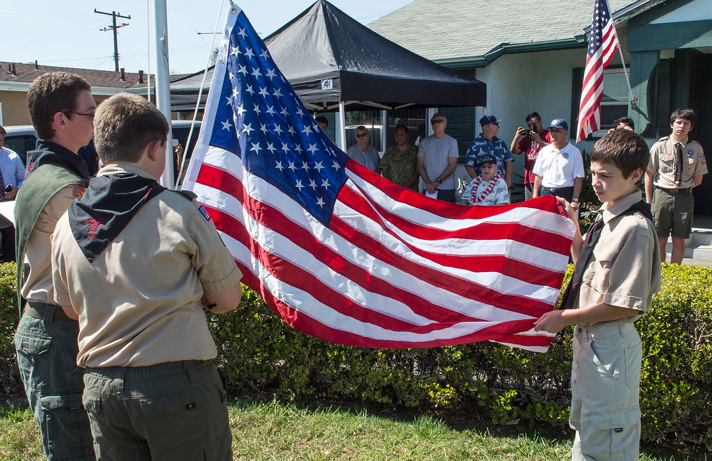 . World War II veteran Lauren Bruner, center, 96, watches as  members of Boy Scout Troop 749, Jacob Gurr, 16, from left, Justin Degener, 13, and Ben Irving, 12, prepare to raise the American Flag during a flag-raising ceremony in La Mirada on Saturday, March 11, 2017. Lauren Bruner is one of the remaining survivors of the Pearl Harbor attack on Dec. 7, 1941. Bruner was stationed on the USS Arizona. (Photo by Ed Crisostomo, Los Angeles Daily News/SCNG)