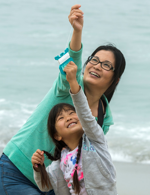 . Sachi Yamauchi, of Torrance, helps her daughter Amy, 6, with the string to her kite while flying it at the 43rd Annual Festival of the Kite at the Redondo Beach Pier in Redondo Beach Sunday, March 12, 2017. (Photo by Thomas R. Cordova, Daily Breeze/SCNG)