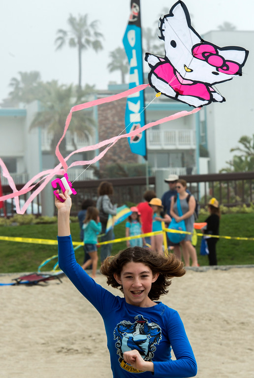. Reagan Adams, 12 of Adelanto, runs to get her Hello Kitty kite in the air while at the 43rd Annual Festival of the Kite at the Redondo Beach Pier in Redondo Beach Sunday, March 12, 2017. (Photo by Thomas R. Cordova, Daily Breeze/SCNG)