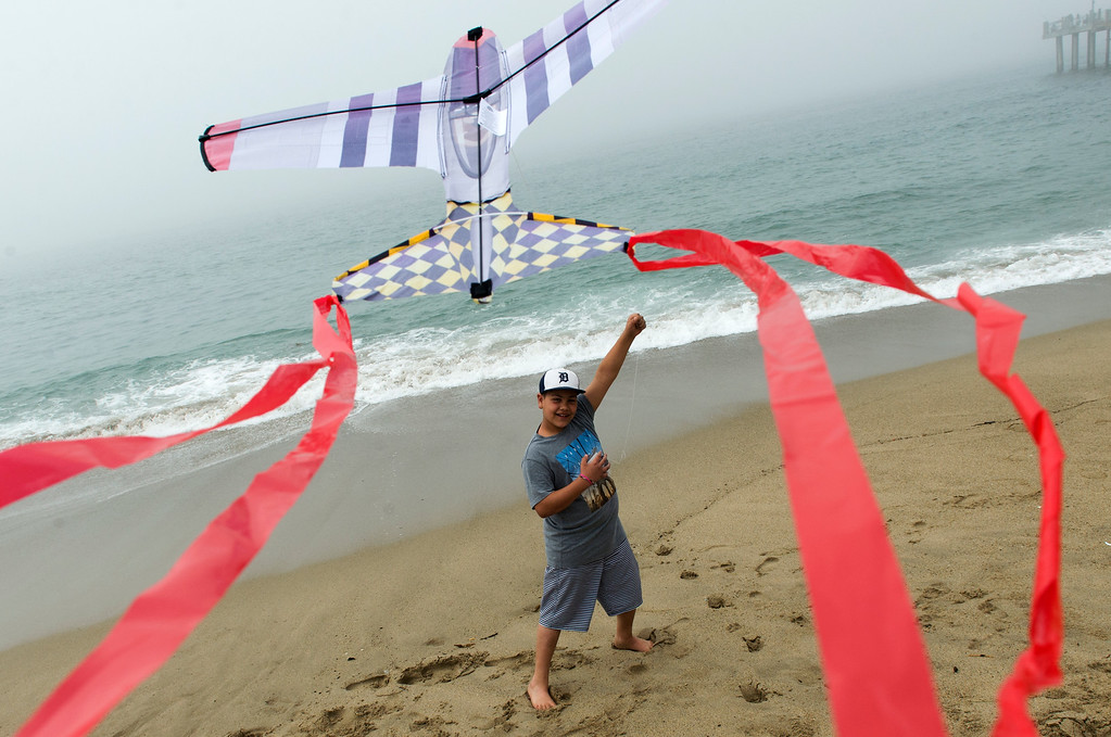 . Luca Losada-Megina, 9 of Corona, attempts to fly his kite while at the 43rd Annual Festival of the Kite at the Redondo Beach Pier in Redondo Beach Sunday, March 12, 2017. (Photo by Thomas R. Cordova, Daily Breeze/SCNG)