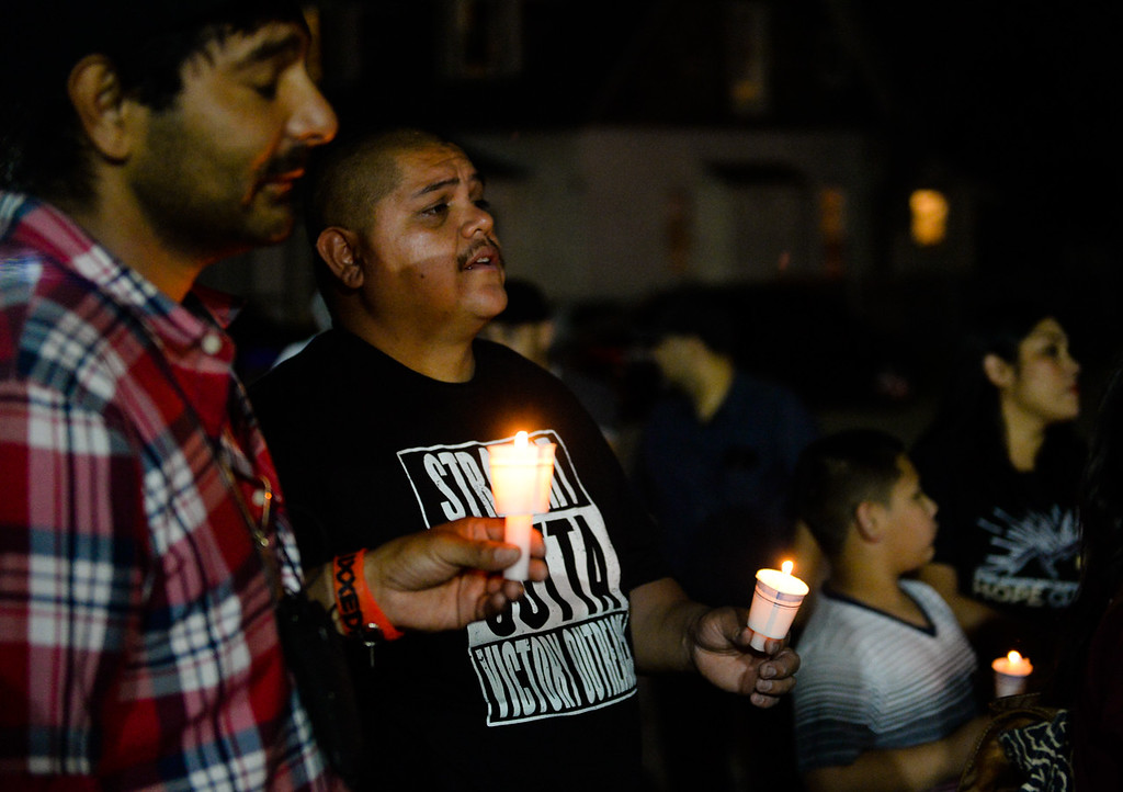 . Family, friends and community members sing songs during a prayer vigil to remember the death of 12-year-old Jason Spears in San Bernardino, Calif. on Monday, March 13, 2017. Jason was shot a 12-year-old shot while trying to get chips from a nearby liquor store on March 13, 2016. (Photo by Rachel Luna, The Sun/SCNG)