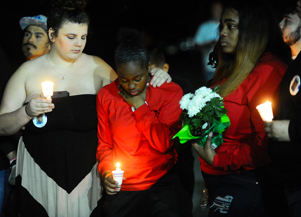 . Family, friends and community members gather for a prayer vigil to remember the death of 12-year-old Jason Spears in San Bernardino, Calif. on Monday, March 13, 2017. Jason was shot a 12-year-old shot while trying to get chips from a nearby liquor store on March 13, 2016. (Photo by Rachel Luna, The Sun/SCNG)