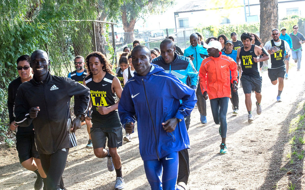 . Kenyans Willy Koitile, from left, Daniel Limo, 2015 Skechers Performance Los Angeles Marathon Champion, and Weldon Kirui, 2016 Skechers Performance Los Angeles Marathon Defending Champion, lead the run with Students Run LA\'s teens and coaches as well as elite marathon runners from Kenya during a short training run at Griffith Park in Los Angeles on Friday, March 17, 2017. (Photo by Ed Crisostomo, Los Angeles Daily News/SCNG)