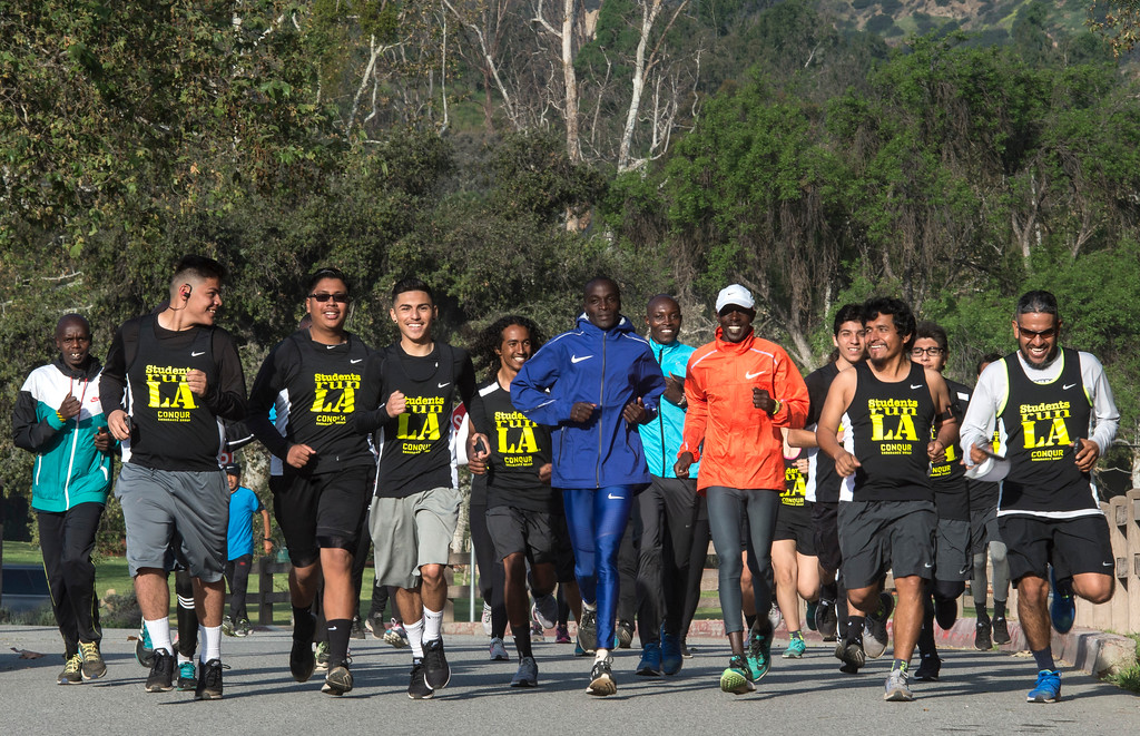 . Daniel Limo, center, of Kenya, 2015 Skechers Performance Los Angeles Marathon Champion, leads the run with Students Run LA\'s teens and coaches as well as elite marathon runners from Kenya during a short training run at Griffith Park in Los Angeles on Friday, March 17, 2017. (Photo by Ed Crisostomo, Los Angeles Daily News/SCNG)