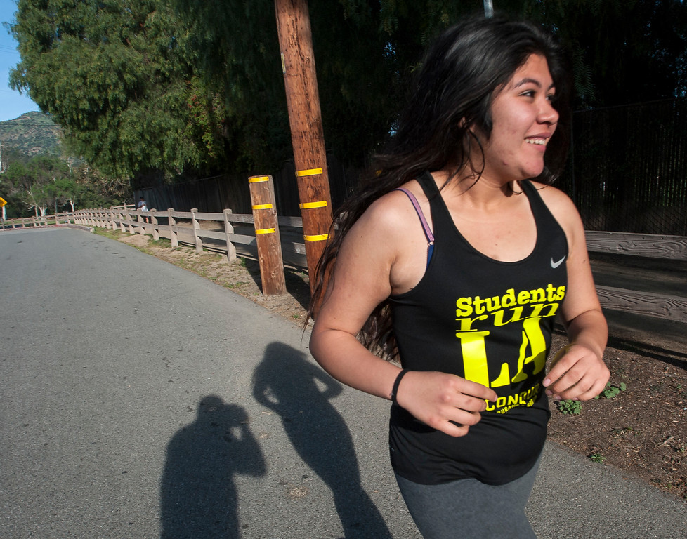 . Jenny Martinez, 17, Students Run LA, runs with coaches as well as elite marathon runners from Kenya during a short training run at Griffith Park in Los Angeles on Friday, March 17, 2017. (Photo by Ed Crisostomo, Los Angeles Daily News/SCNG)