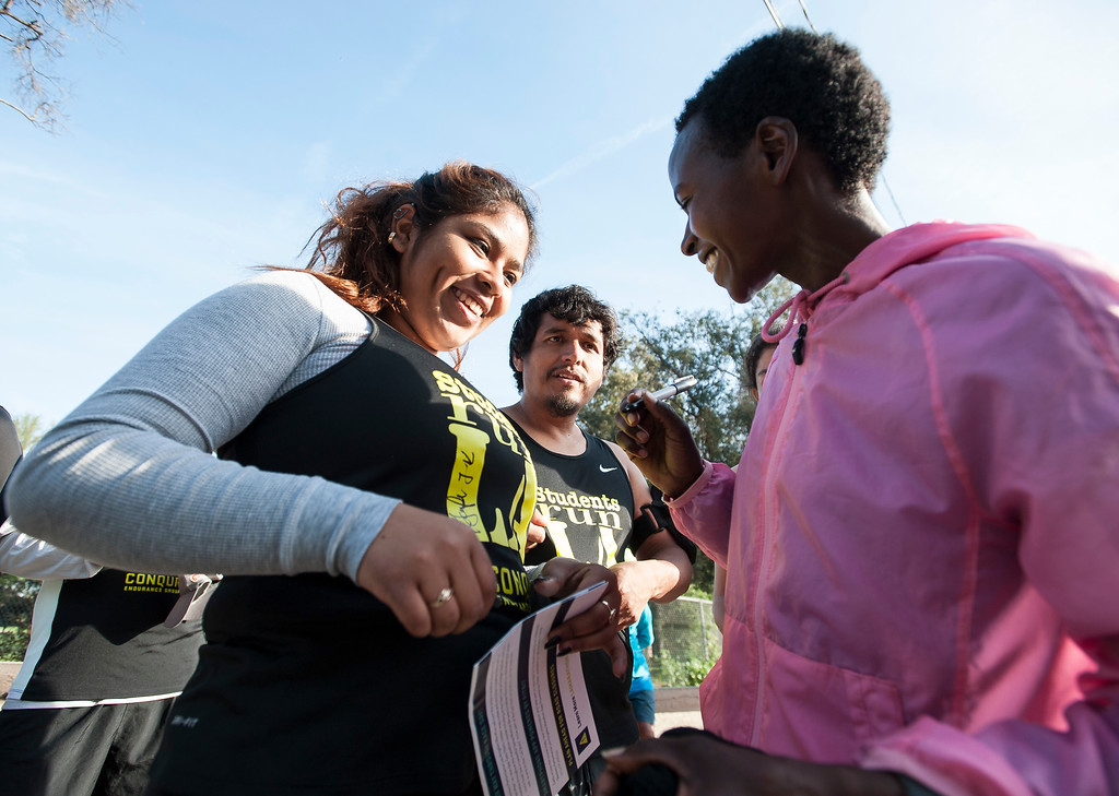 . Areli Gutierrez, 17, Students Run LA, smiles as she gets an autograph from elite marathon runner Jane Kibii, right, of Kenya, after a short training run at Griffith Park in Los Angeles on Friday, March 17, 2017. (Photo by Ed Crisostomo, Los Angeles Daily News/SCNG)