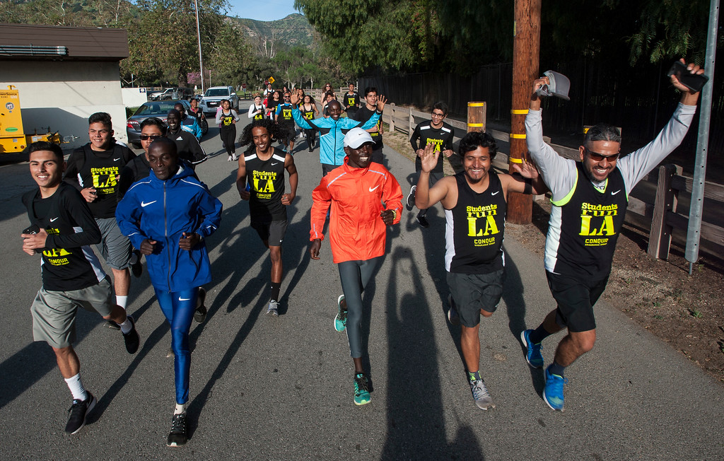 . Daniel Limo, second from the left, of Kenya, 2015 Skechers Performance Los Angeles Marathon Champion, leads the run with Students Run LA\'s teens and coaches as well as elite marathon runners from Kenya during a short training run at Griffith Park in Los Angeles on Friday, March 17, 2017. (Photo by Ed Crisostomo, Los Angeles Daily News/SCNG)