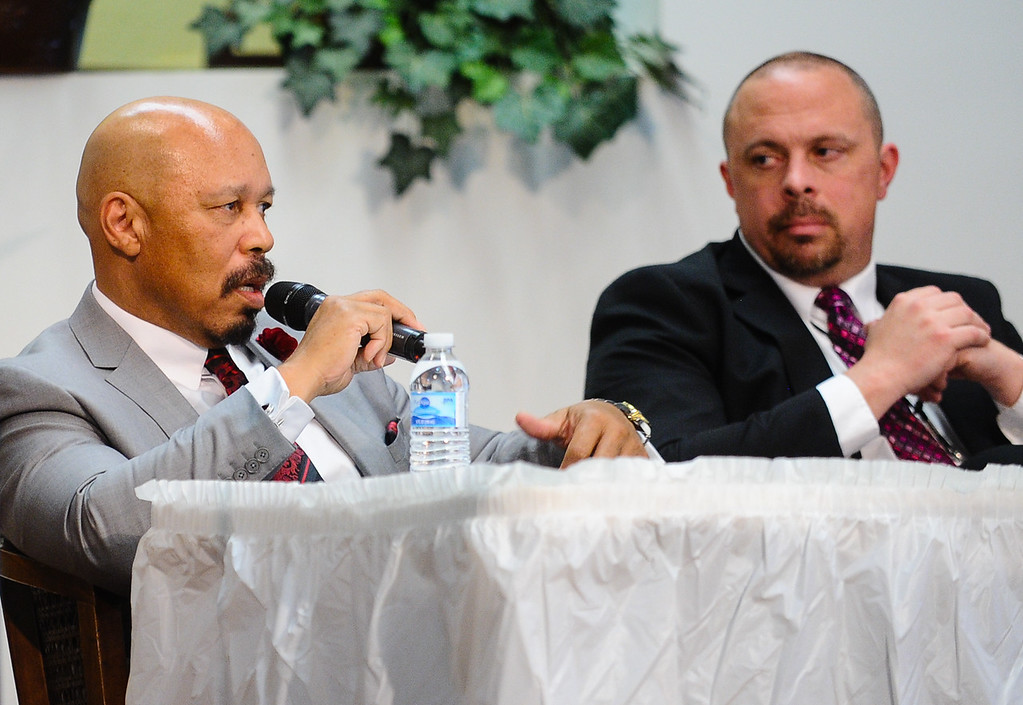 """. Dr. Dorian Burton with Christian Counseling Service in Redlands, left, and Sean Daugherty, San Bernardino County supervising deputy district attorney, speak at the 17th annual Faith and Justice Summit held at First Assembly of God in Yucaipa, Calif. on Thursday, March 16, 2017. The theme of this year\'s summit is \""""Community and Police Relations\"""" with a focus on \""""Mental Health First Aid.\"""" (Photo by Rachel Luna, Redlands Daily Facts/SCNG)"""