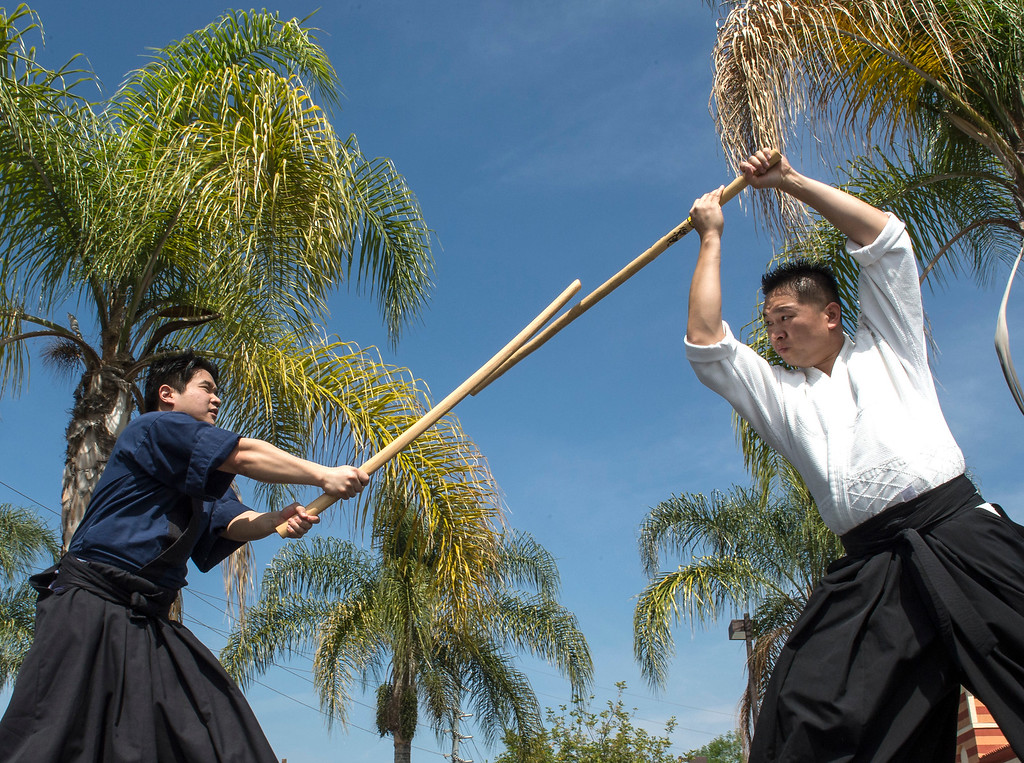 . Members of Shinkendo, Adam Matsui, left, and Andrew Tang show their skills during The Annual West Covina Cherry Blossom Festival in West Covina on Saturday, March 18, 2017. (Photo by Ed Crisostomo, Los Angeles Daily News/SCNG)