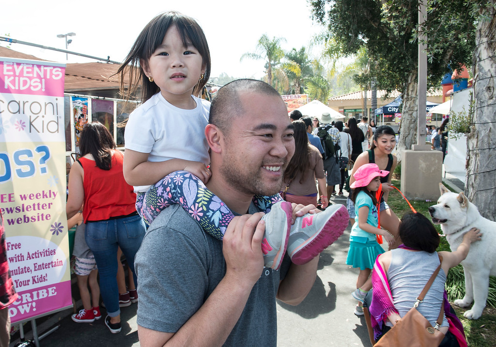 . Long Vu, of Chino Hills, spends time with his daughter Athena, 2, at The Annual West Covina Cherry Blossom Festival in West Covina on Saturday, March 18, 2017. (Photo by Ed Crisostomo, Los Angeles Daily News/SCNG)