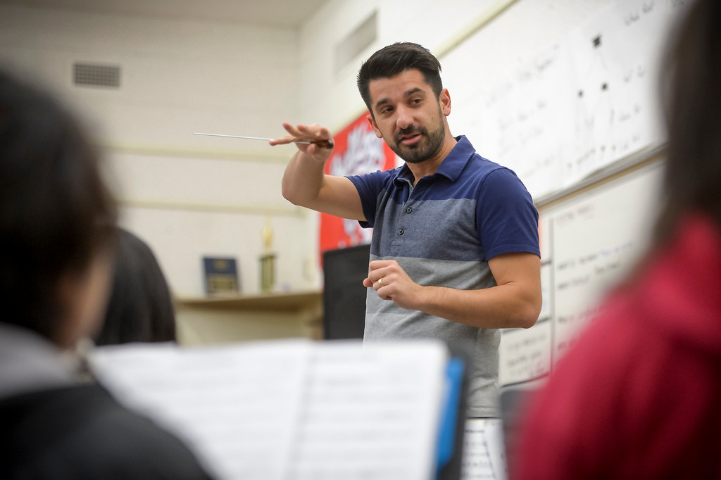 . Cleveland high music teacher Cameron Yassaman conducts during band rehearsal. Due to budget cuts the school went without a music teacher for several years, but a group of 9 students kept the band going as a student-run club. Now, the school has hired Yassaman and music programs at the school include marching band in the fall, a jazz band and two other groups.  ( Photo by David Crane, Los Angeles Daily News/SCNG)