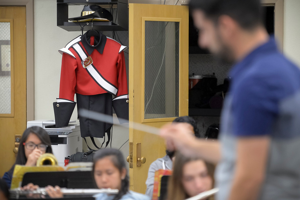 . A marching band uniform hangs in the band room at Cleveland high as music teacher Cameron Yassaman conducts during band rehearsal. Due to budget cuts the school went without a music teacher for several years, but a group of 9 students kept the band going as a student-run club. Now, the school has hired Yassaman and music programs at the school include marching band in the fall, a jazz band and two other groups.  ( Photo by David Crane, Los Angeles Daily News/SCNG)