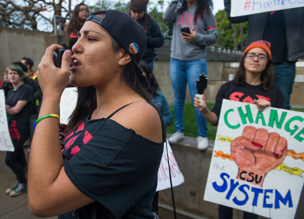 . Cecilia Ruesta, of  Fresno State, lead the crowed in chants as students and supporters protest outside of the California State University Office of the Chancellor as the CSU Trustees finance committee vote on a tuition increase on a 7 to 2 vote in Long Beach Wednesday, March 22, 2017.  (Photo by Thomas R. Cordova, Press-Telegram/SCNG)