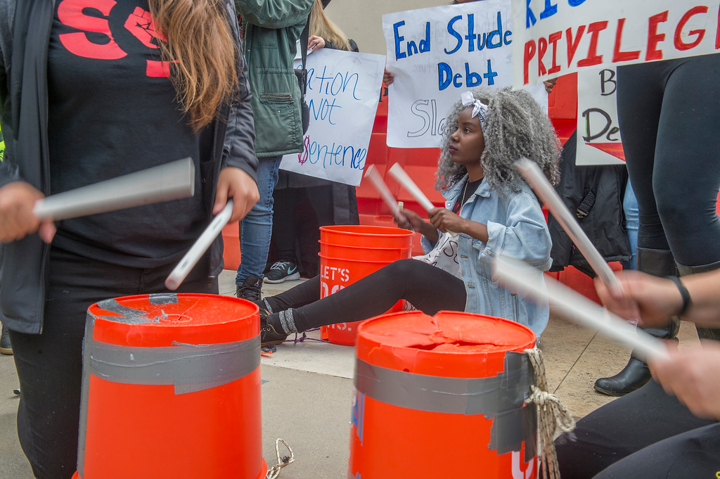 . Shiba Bandeeba, of San Fransico State, plays the bucket at a protest with other students and supporters outside of the California State University Office of the Chancellor as the CSU Trustees finance committee vote on a tuition increase on a 7 to 2 vote in Long Beach Wednesday, March 22, 2017.  (Photo by Thomas R. Cordova, Press-Telegram/SCNG)