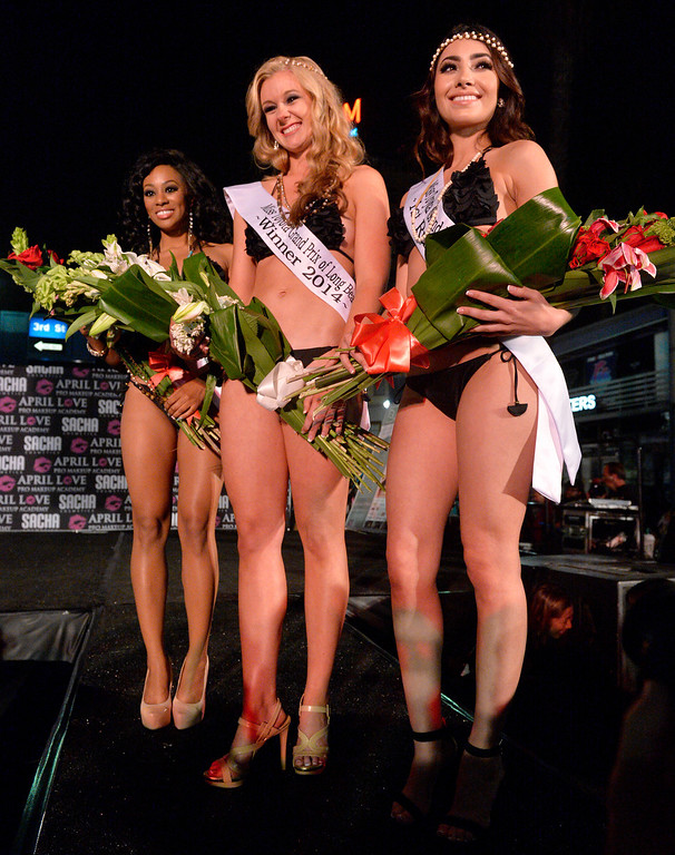. L-R Shannon Fox, third runner up, Jessica Jenkins winner and Clarissa Burquez second runner up at Miss Toyota Grand Prix competition at theThunder Thursday on Pine  part of  Long Beach Grand Prix in in Long Beach CA. Thursday April 10, 2014.  (Thomas R. Cordova-Daily Breeze/Press-Telegram)