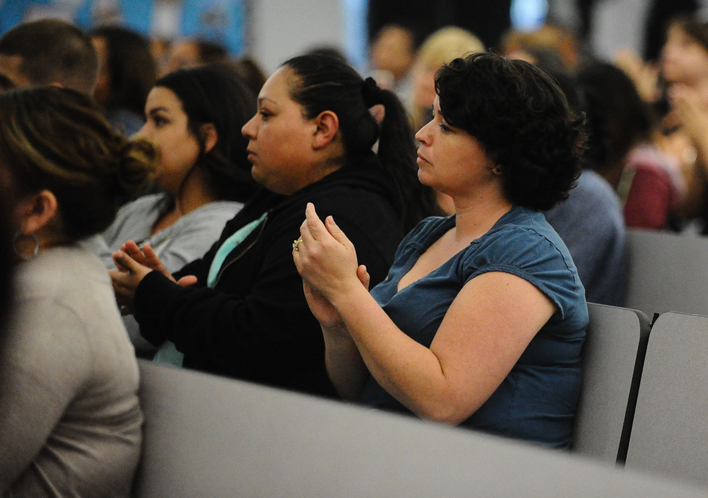 . Parents and community members applaud after superintendent Dale Marsden announces locks will be placed on North Park Elementary doors as they gather for a meeting at Bob Holcomb Elementary School in San Bernardino, Calif. on Thursday, April 13, 2017. Cedric Anderson, 53, of Riverside, entered North Park Elementary School, killing his his estranged wife Karen Elaine Smith, 53, student Jonathan Martinez, 8, and critically injuring another student before turning the gun on himself on April 10 at the school in San Bernardino. (Photo by Rachel Luna, The Sun/SCNG)