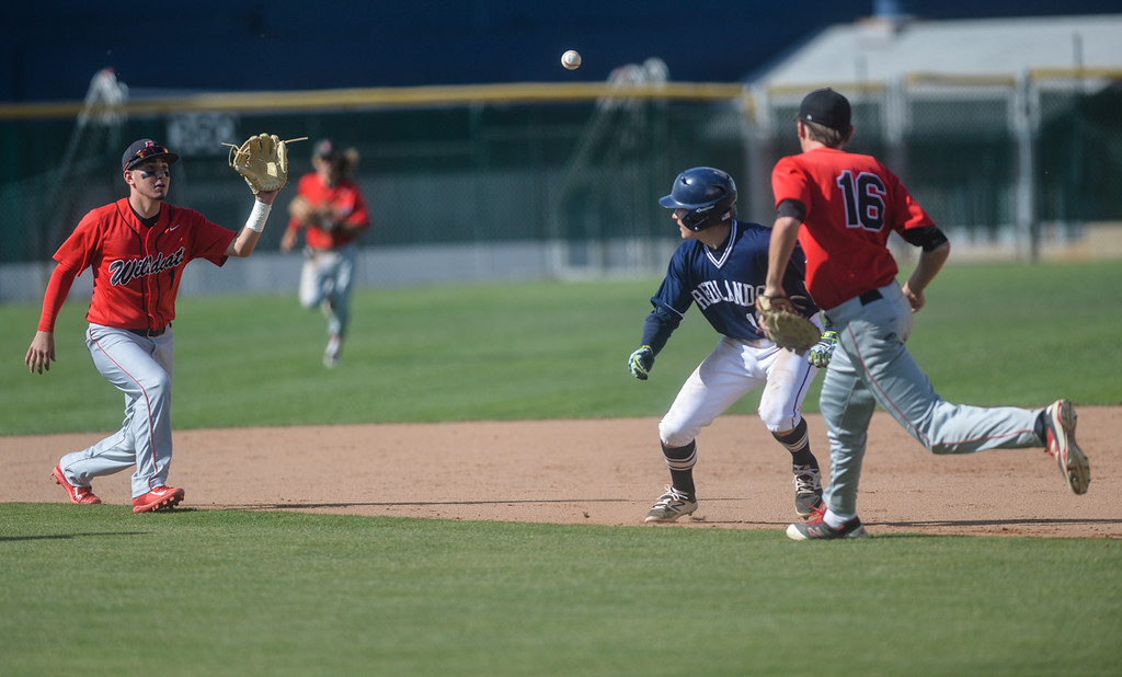 . Redlands\' Alec Weissman (13) gets caught in a pickle between Redland East Valley\'s Joe Rodriguez (1) and Dylan Fashempour (16) in a boys baseball game at Redlands High School in Redlands, Calif. on Thursday, April 13, 2017. REV defeated Redlands, 5-3. (Photo by Rachel Luna, Redlands Daily Facts/SCNG)