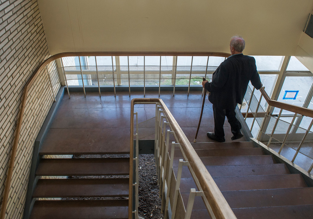 . Andy Hale, 75, the assistant scoutmaster for Boy Scout Troop 25, walks down to the first floor after exiting Boy Scout Troop 25 room in Long Beach Wednesday, April 12, 2017. Hale is looking for new home for the troop because the property is being redeveloped into a mixed-use development with a church,  condos, and stores.  (Photo by Thomas R. Cordova, Press-Telegram/SCNG)