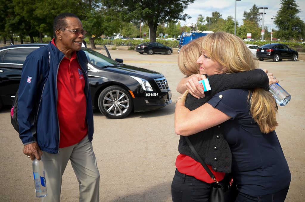 . Mary Reuland hugs Rhonda Carew as baseball hall of fame legend Rod Carew, looks on as the trio meet for a press conference for the American Heart Association.  Mary\'s son Konrad Reuland\'s heart was donated to Carew in December of 2016.  ( Photo by David Crane, Los Angeles Daily News/SCNG)
