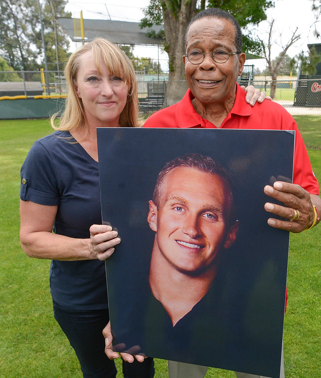. Mary Reuland and baseball hall of fame legend Rod Carew, hold a photo of Konrad Reuland who\'s heart was donated to Carew in December of 2016.  Mary was Konrad\'s mother.  The pair are working together for the American Heart Asscoiation.  ( Photo by David Crane, Los Angeles Daily News/SCNG)