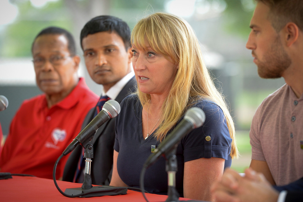 . Mary Reuland talks about her son Konrad during a press conference for the American Heart Association. Baseball hall of fame legend Rod Carew, far left, was given Mary\'s son Konrad Reuland\'s heart after he suffered a brain aneurysm in December of 2016.  Next to Mary is Carew\'s doctor, Dr. Ajay Srivastava.  ( Photo by David Crane, Los Angeles Daily News/SCNG)