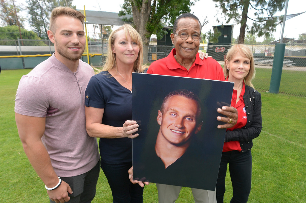 . L to R; Austin Reuland, Mary Reuland, Rod Carew, Rhonda Carew.  Rod Carew holds a photo of Konrad Reuland who\'s heart was donated to Carew in December of 2016.  Austin is Konrad\'s brother, Mary is Konrad\'s mother.  Rhonda is Rod\'s wife.  ( Photo by David Crane, Los Angeles Daily News/SCNG)