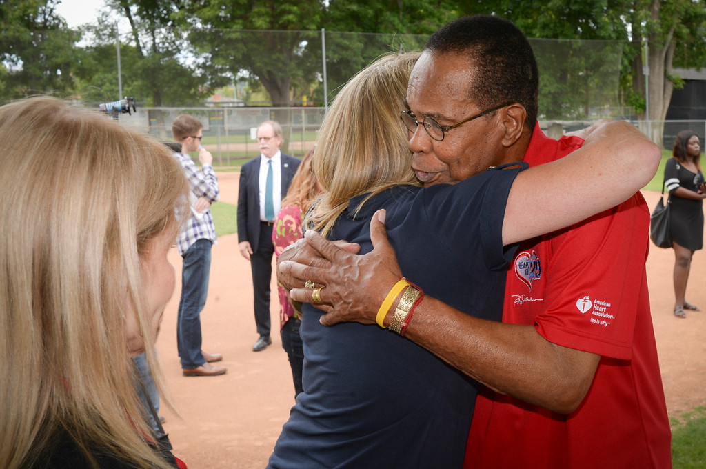 . Baseball hall of fame legend Rod Carew hugs Mary Reuland after a press conference for the American Heart Association.  Mary\'s son Konrad Reuland\'s heart was donated to Carew in December of 2016 after the NFL player suffered from a brain aneurysm while working out.  ( Photo by David Crane, Los Angeles Daily News/SCNG)