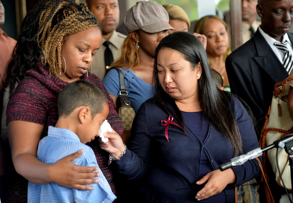. Pam Adel, the victims girlfriend, right, riends and family of stand together at a press conference in Compton to announce a $20,000 reward for information in the shooting death of Tauruson McMillian who was killed on January 4, 2014 in Compton. McMillian was driving through the city in his red SS Monte Carlo when approached and shot. Compton April 23, 2014. (Photo by Brittany Murray / Daily Breeze)