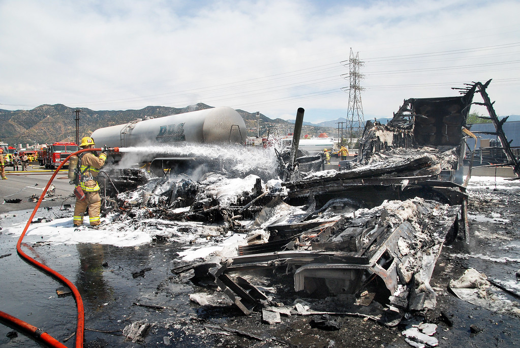 . One big rig is completely burned in a five-vehicle crash Tuesday, April 25, 2017, on the 5 Freeway near Colorado Boulevard in the Griffith Park area that closed all lanes, killing one person and injuring nine others. (Photo by Mike Meadows/Special to the Los Angeles Daily News)