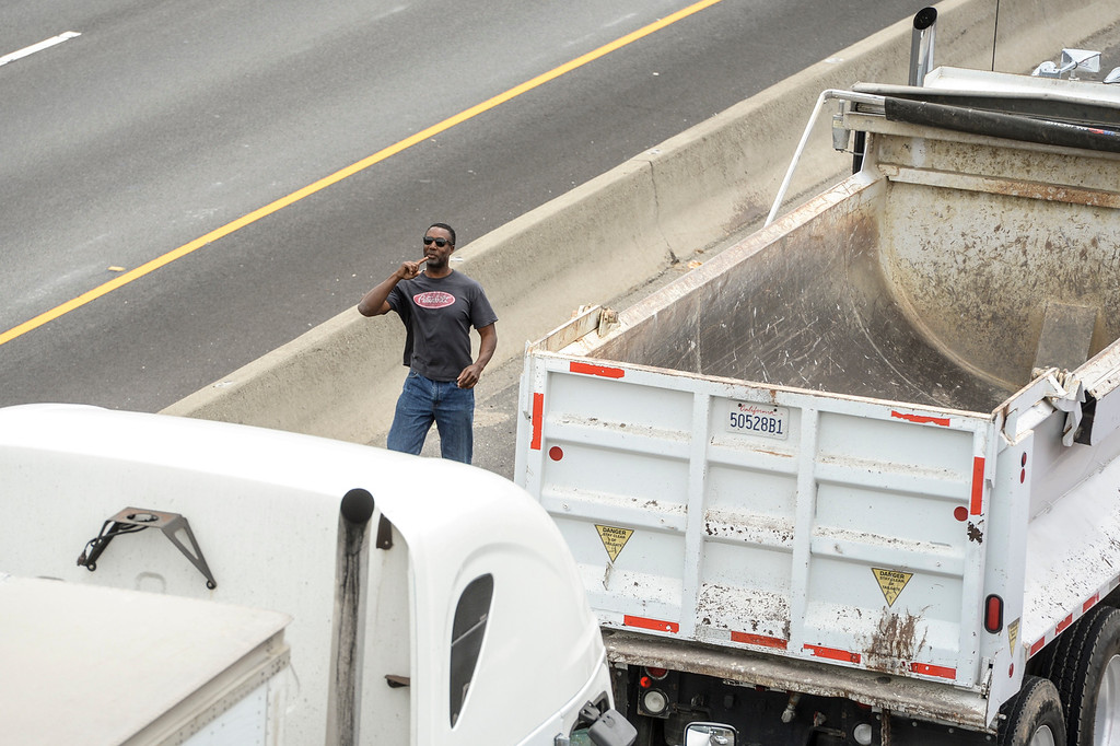 . A truck driver trapped on the I-5 freeway surveys his options after a deadly crash involving several vehicles and a big rig shut down both northbound and southbound lanes of the I-5 Freeway in Glendale at Colorado street Tuesday, April 25, 2017.   ( Photo by David Crane, Los Angeles Daily News/SCNG)